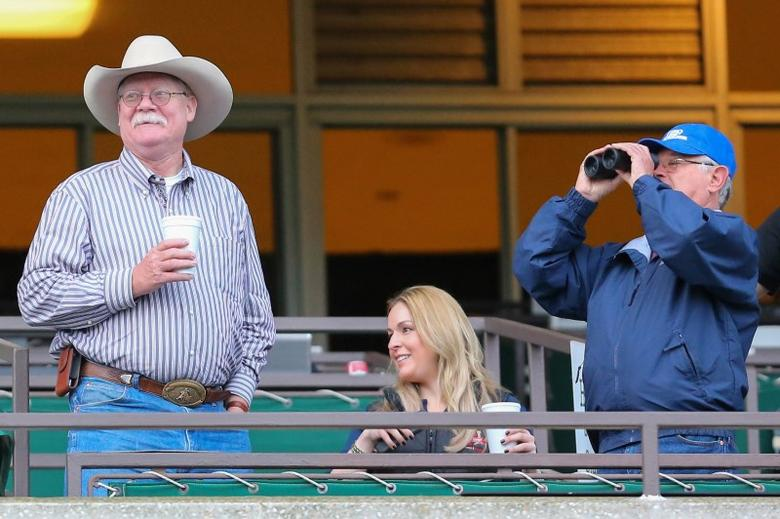 California Chrome co owner Steve Coburn (left) and trainer Art Sherman view the morning workout in preparation for the 2014 Belmont Stakes at Belmont Park. Mandatory Credit: Anthony Gruppuso-USA TODAY Sports
