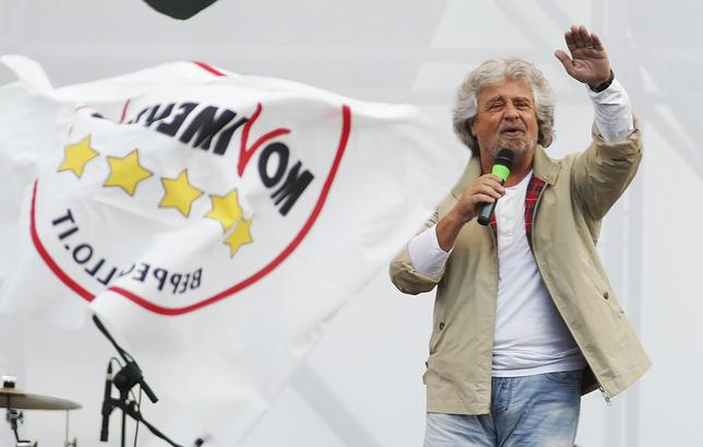Leader of the Five Star Movement and comedian Beppe Grillo gestures while speaking during an election campaign for European Parliament elections in Rome May 23, 2014 REUTERS/Remo Casilli