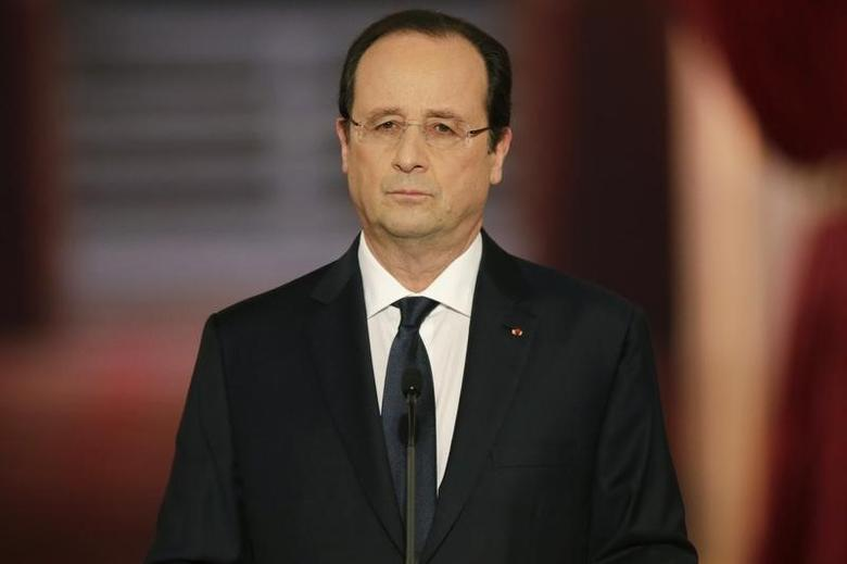 French President Francois Hollande listens to a question during a news conference at the Elysee Palace in Paris, January 14, 2014.   REUTERS/Philippe Wojazer