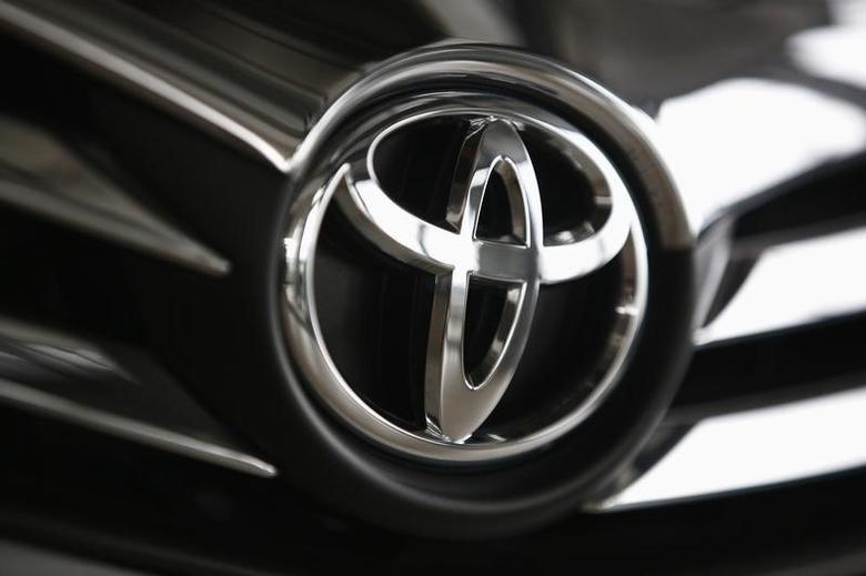 A Toyota logo is seen on a car inside a showroom at a Toyota dealership in Warsaw April 11, 2014. REUTERS/Kacper Pempel/Files