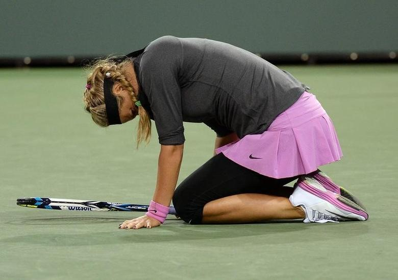 Mar 7, 2014; Indian Wells, CA, USA;  Victoria Azarenka (BLR) grimaces as she lands on her left ankle during her match against Lauren Davis (not pictured) at the BNP Paribas Open at the Indian Wells Tennis Garden. Davis won 6-0, 7-6. Mandatory Credit: Jayne Kamin-Oncea-USA TODAY Sports
