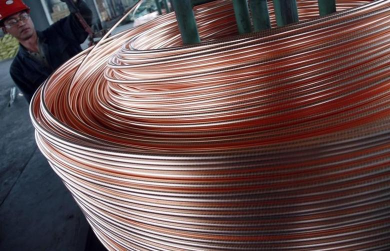 An employee unloads copper at a factory in Nantong, Jiangsu province, June 18, 2011. Premiums in Chinese copper markets rallied to their highest in almost three years this week as robust demand met tight local supply, industry sources said, although levels could ease slightly near term. Picture taken June 18, 2011. REUTERS/China Daily (CHINA - Tags: BUSINESS INDUSTRIAL) CHINA OUT. NO COMMERCIAL OR EDITORIAL SALES IN CHINA - RTR3NHUA