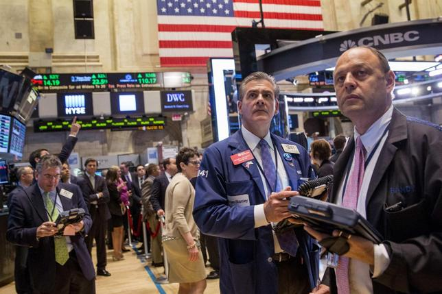 Traders work on the floor of the New York Stock Exchange June 13, 2014. REUTERS/Brendan McDermid
