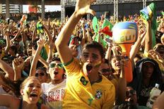Brazilian fans celebrate after Brazil scored against Croatia during their 2014 World Cup opening match, at a FIFA event in Manaus June 12 2014.  REUTERS/Siphiwe Sibeko