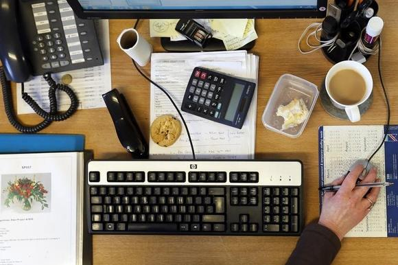 A cup of tea is seen on an office table at the Tregothnan Estate near Truro in Cornwall January 15, 2013. REUTERS/Stefan Wermuth/Files