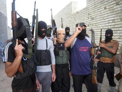 Advancing Iraq rebels seize northwest town in heavy...