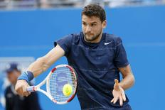 Bulgaria's Grigor Dimitrov returns the ball to Spain's Feliciano Lopez during their men's singles final tennis match at the Queen's Club Championships in west London June 15, 2014. REUTERS/Stefan Wermuth