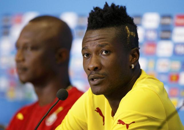 Ghana national soccer team captain Asamoah Gyan (R) speaks next to team coach James Kwesi Appiah during a news conference before their training session at the Dunas Arena soccer stadium in Natal June 15, 2014.  REUTERS/Toru Hanai