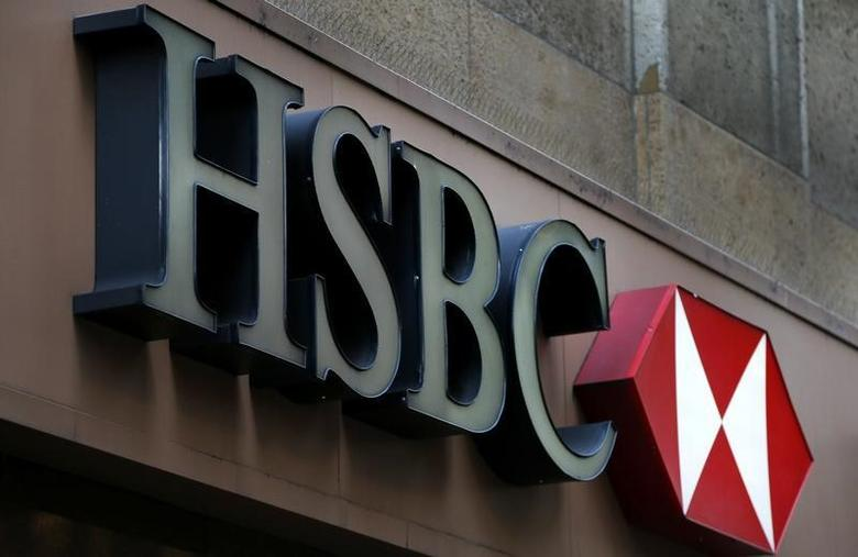 A sign is seen above the entrance to an HSBC bank branch in midtown Manhattan in New York City, December 11, 2012. HSBC has agreed to pay a record $1.92 billion fine to settle a multi-year probe by U.S. prosecutors, who accused Europe's biggest bank of failing to enforce rules designed to prevent the laundering of criminal cash. REUTERS/Mike Segar  (UNITED STATES - Tags: BUSINESS CRIME LAW LOGO) - RTR3BG8F