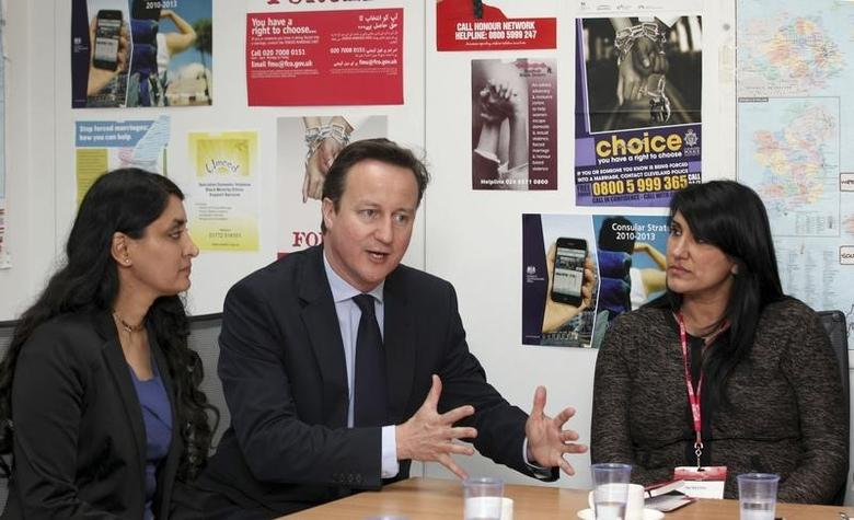 Britain's Prime Minister David Cameron speaks, with Aneeta Prem from Freedom Charity (L) and Jasvinder Sanghera of Karwia Nirvana, during a meeting with the forced marriage unit in the Foreign Office in central London June 8, 2012.  REUTERS/Jon Bond/Pool