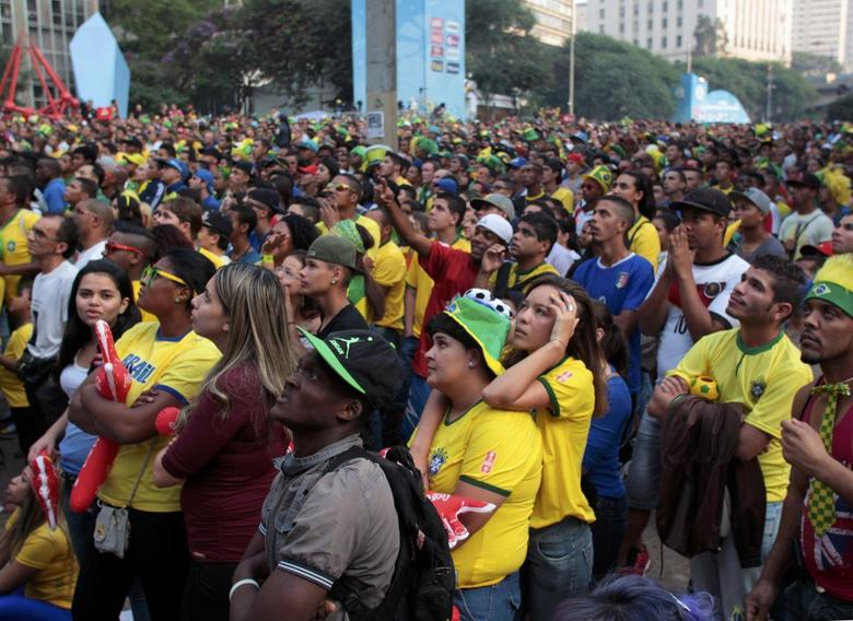REFILE - CORRECTING BYLINESoccer fans react while watching the 2014 World Cup Group A soccer match between Brazil and Mexico, at a public viewing area in Sao Paulo June 17, 2014. REUTERS/Chico Ferreira