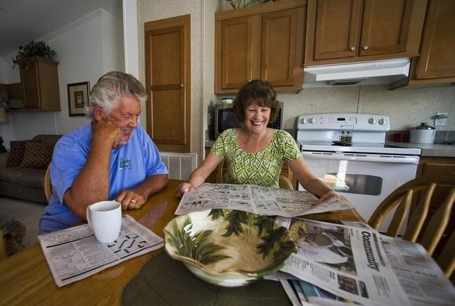 Mark Findlay and his wife Delores Findlay, of Erie, Pennsylvania, read the morning newspaper inside their home at Limetree Park where they spend the winter months in Bonita Springs, Florida, March 23, 2012.  REUTERS/Steve Nesius
