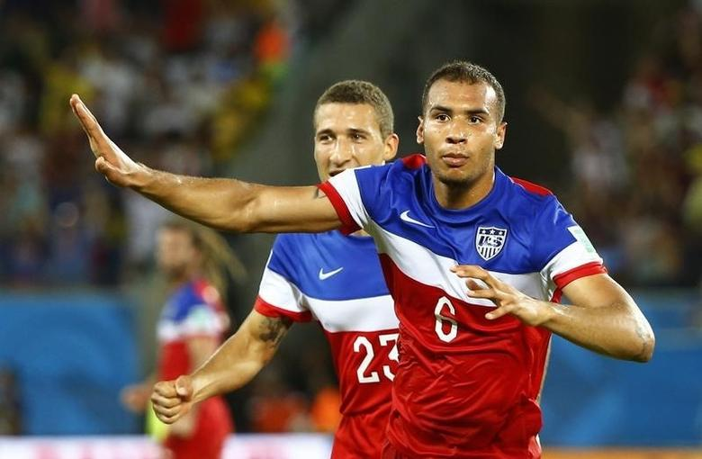John Brooks of the U.S. celebrates his goal against Ghana with teammate Fabian Johnson (L) during their 2014 World Cup Group G soccer match at the Dunas arena in Natal June 16, 2014.   REUTERS/Stefano Rellandini
