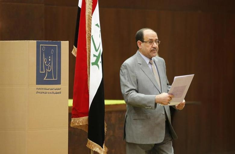 Iraq's Prime Minister Nuri al-Maliki prepares to vote during parliamentary election in Baghdad April 30, 2014. REUTERS/Ahmed Jadallah