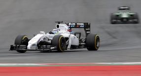 Williams Formula One driver Felipe Massa (L) of Brazil pilots his car during the qualification for the Austrian Grand Prix at the Red Bull Ring circuit in Spielberg June 21, 2014.         REUTERS/David W Cerny