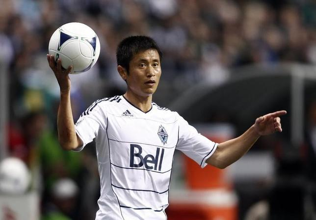 Vancouver Whitecaps Lee Young-pyo throws in the ball during the second half of their MLS soccer match against Montreal Impact in Vancouver, British Columbia March 10, 2012. REUTERS/Ben Nelms/Files