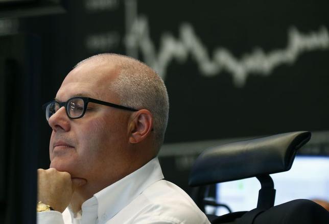 A trader works at Frankfurt stock exchange June 5, 2014. REUTERS/Ralph Orlowski