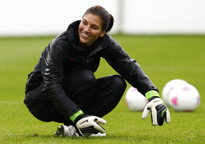 Hope Solo, goalkeeper from the U.S. women's Olympic soccer team, laughs during a team training session ahead of the London 2012 Olympic Games, in Glasgow, Scotland in this July 18, 2012 file photo. REUTERS/David Moir/Files