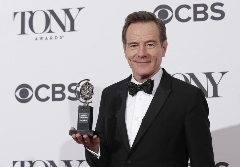 Actor Bryan Cranston poses backstage with his Tony Award for best performance by an actor in a leading role in a play for ''All the Way'' at the American Theatre Wing's 68th annual Tony Awards at Radio City Music Hall in New York, June 8, 2014. REUTERS/Andrew Kelly
