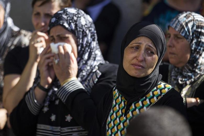 A relative mourns during the funeral of Mohammed Qaraqara in the northern town of Arabeh June 23, 2014. REUTERS/Baz Ratner