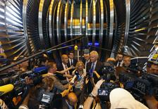 Clara Gaymard, the head of GE France (C), General Electric Chairman and CEO Jeffrey Immelt (R) and Alstom Chairman and Chief Executive Patrick Kron (L) answer journalists questions as they stand in front off a steam turbine at the turbines production unit of the Alstom plant in Belfort, June 24, 2014.  REUTERS/Vincent Kessler