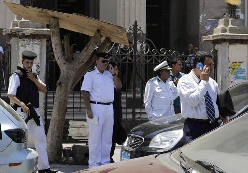 String of small morning explosions in Cairo hurt eight