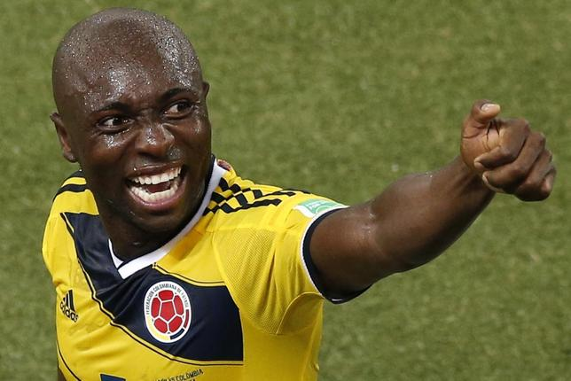 Colombia's Pablo Armero celebrates after their win against Japan as he leaves the pitch after their 2014 World Cup Group C soccer match at the Pantanal arena in Cuiaba June 24, 2014. REUTERS/Suhaib Salem