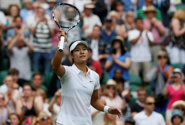 Li Na of China reacts after defeating Paula Kania of Poland in their women's singles tennis match at the Wimbledon Tennis Championships, in London June 23, 2014.          REUTERS/Stefan Wermuth