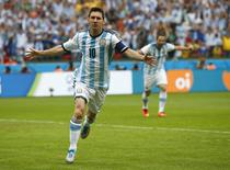 Argentina's Lionel Messi celebrates after scoring against Nigeria June 25, 2014. REUTERS/Darren Staples
