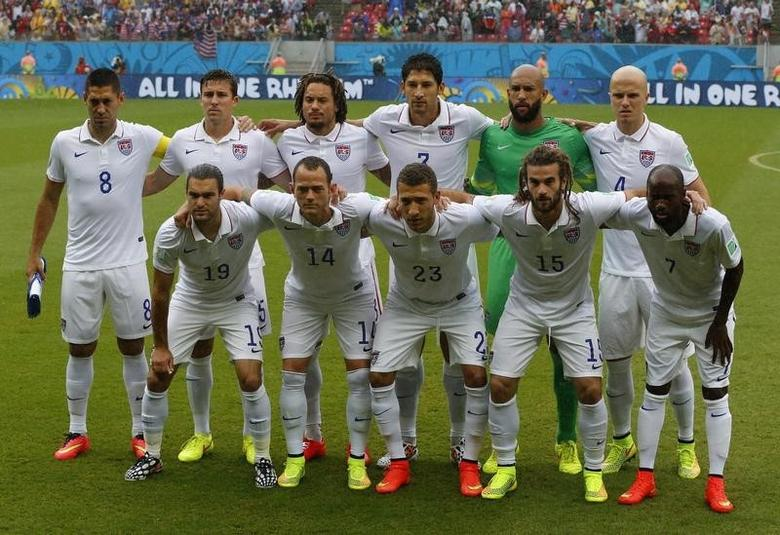 U.S. national soccer team players pose for photographs before the start of their 2014 World Cup Group G soccer match against Germany at the Pernambuco arena in Recife June 26, 2014.  REUTERS/Yves Herman