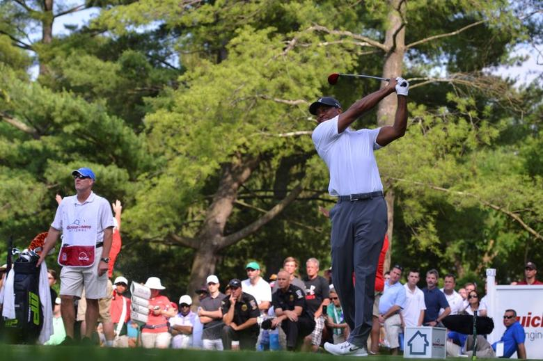Jun 27, 2014; Bethesda, MD, USA; Tiger Wood hits his tee shot on the 16th hole during the second round of the Quicken Loans National golf tournament at Congressional Country Club - Blue Course. Mandatory Credit: Tommy Gilligan-USA TODAY Sports