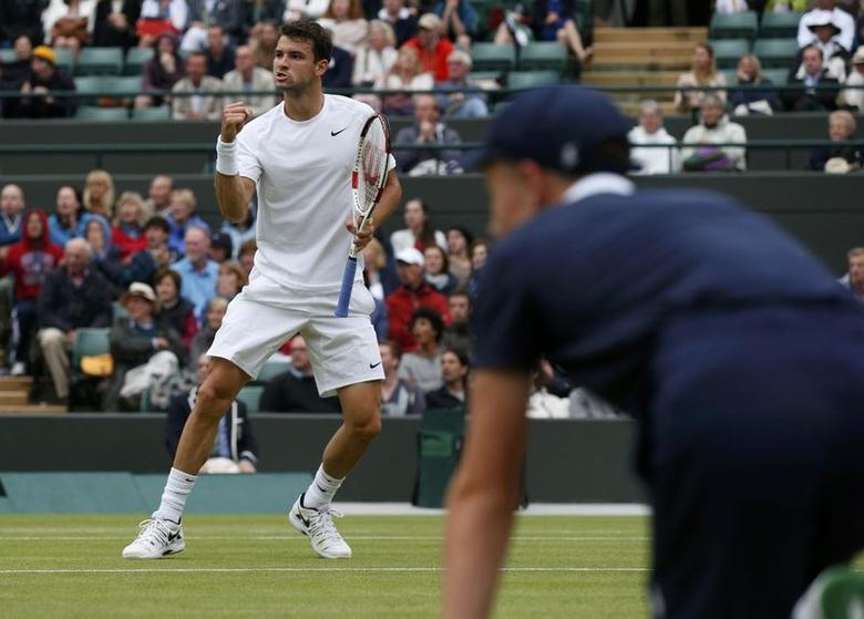 Grigor Dimitrov of Bulgaria reacts during his men's singles tennis match against Leonardo Mayer of Argentina at the Wimbledon Tennis Championships, in London June 30, 2014.             REUTERS/Suzanne Plunkett