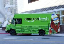 An Amazon delivery truck drives in down town Los Angeles, California  May 13,  2014.    REUTERS/Mike Blake