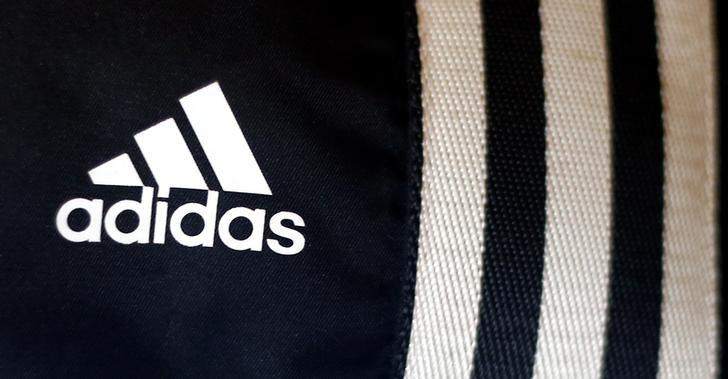 The logo of Adidas, the world's second largest sports apparel firm, is pictured in a store in Munich March 4, 2014.   REUTERS/Michael Dalder