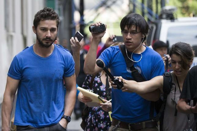 Actor Shia LaBeouf walk as he leaves Midtown Community Court in New York June 27, 2014. REUTERS/Brendan McDermid