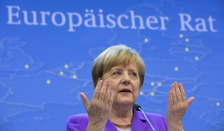Germany's Chancellor Angela Merkel getures during a news conference at the end of a EU summit in Brussels, June 27, 2014. REUTERS/Philippe Wojazer