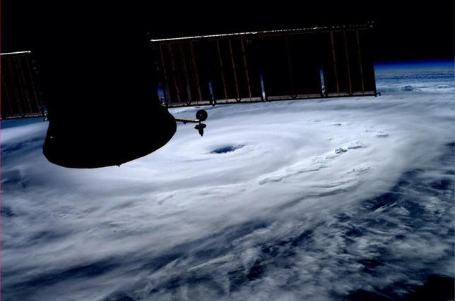 The eye of Hurricane Arthur is seen over the Atlantic in this photo from the International Space Station tweeted by European Space Agency astronaut Alexander Gerst July 3, 2014. REUTERS/Alexander Gerst/NASA