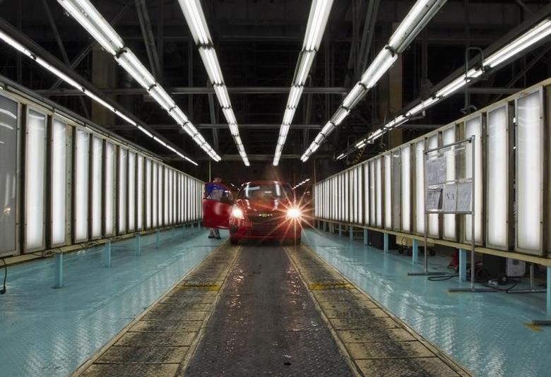 A Chevrolet Spark passes a final check at the General Motors plant in Asaka August 29, 2012.  REUTERS/Shamil Zhumatov