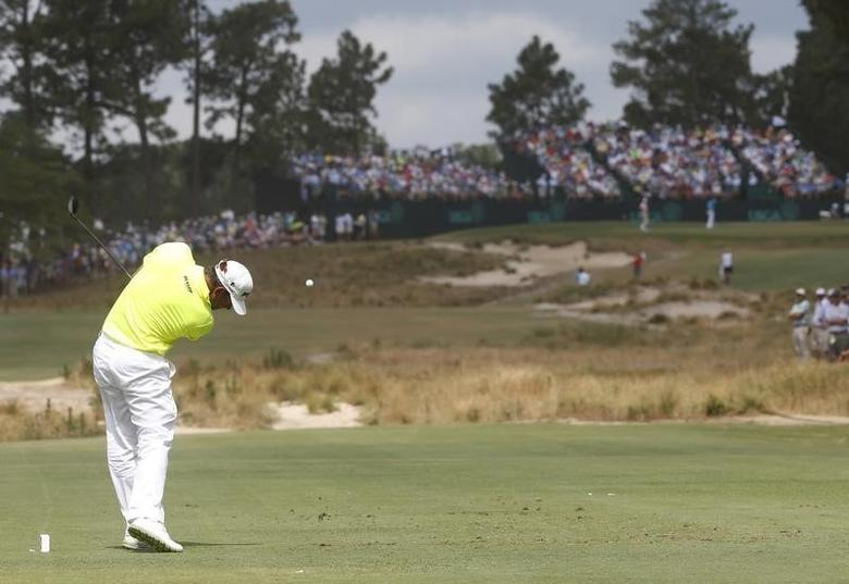 Lee Westwood of England tees off on the 13th hole during the first round of the U.S. Open Championship golf tournament in Pinehurst, North Carolina, June 12, 2014. REUTERS/Mike Segar
