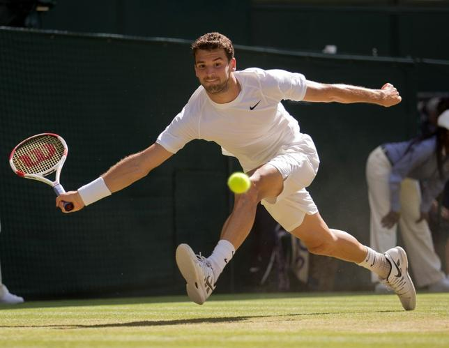 Jul 4, 2014; London, United Kingdom; Grigor Dimitrov (BUL) in action during his match against Novak Djokovic (SRB) on day 11 of the 2014 Wimbledon Championships at the All England Lawn and Tennis Club. Mandatory Credit: Susan Mullane-USA TODAY Sports