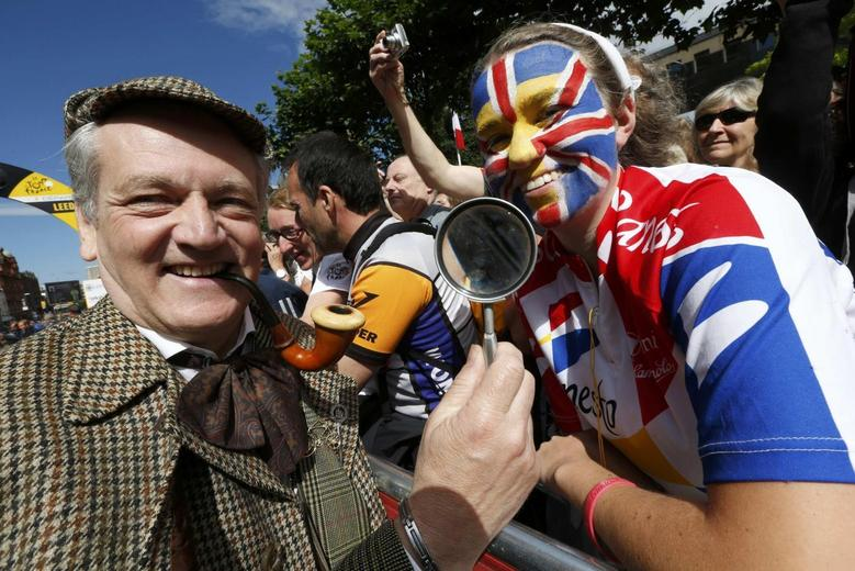 A man dressed in Sherlock Holmes attends the start of the first 190.5 km stage of  the Tour de France cycling race from Leeds to Harrogate, July 5, 2014.       REUTERS/Jean-Paul Pelissier