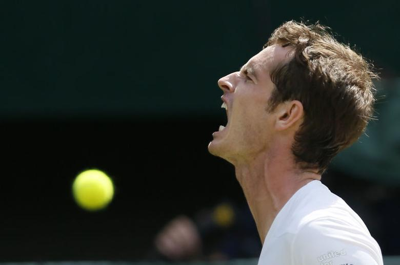 Andy Murray of Britain reacts during his men's singles quarter-final tennis match against Grigor Dimitrov of Bulgaria at the Wimbledon Tennis Championships, in London July 2, 2014.  REUTERS/Stefan Wermuth