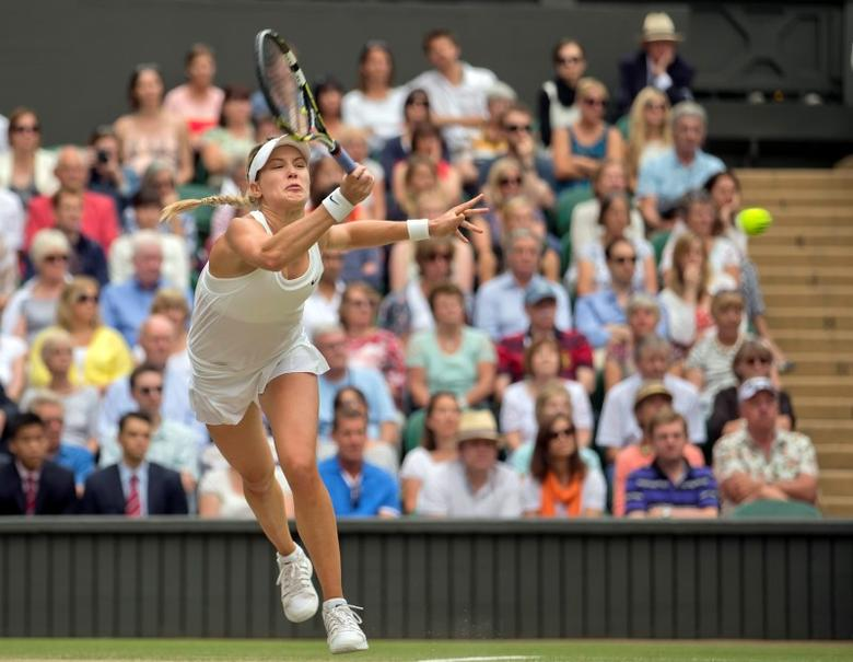 Jul 5, 2014; London, United Kingdom; Eugenie Bouchard (CAN) in action during her match against Petra Kvitova (CZE) on day 12 of the 2014 Wimbledon Championships at the All England Lawn and Tennis Club.  Susan Mullane-USA TODAY Sports