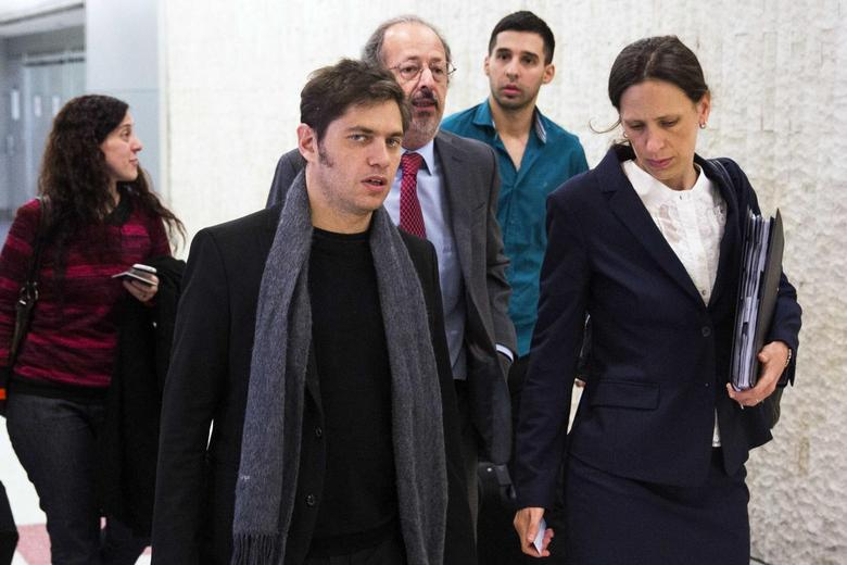 Argentina's Economy Minister Axel Kicillof (2nd L) arrives on a flight from Buenos Aires at John F. Kennedy International Airport in New York July 7, 2014.  REUTERS/Lucas Jackson