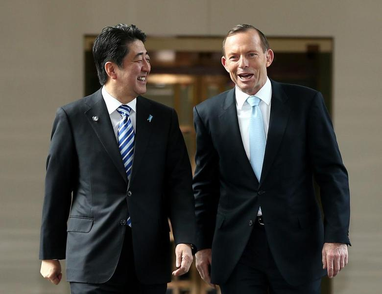 Japan's Prime Minister Shinzo Abe (L) and his Australian counterpart Tony Abbott depart the House of Representatives after Abe's address to a joint sitting at Parliament House in Canberra July 8, 2014. REUTERS/Alex Ellinghausen/Pool