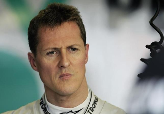 Mercedes Formula One driver Michael Schumacher of Germany is seen in the pits during the first practice session of the Australian F1 Grand Prix at the Albert Park circuit in Melbourne March 25, 2011.  REUTERS/Mark Horsburgh