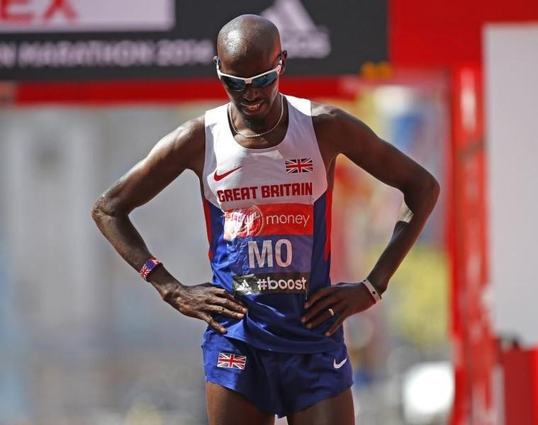 Mo Farah of Britain reacts after finishing in eighth position in the men's Elite London Marathon April 13, 2014. REUTERS/Eddie Keogh