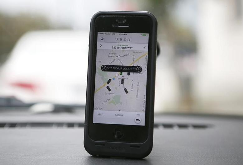 An Uber app is seen on an iPhone in Beverly Hills, California, December 19, 2013.  REUTERS/Lucy Nicholson