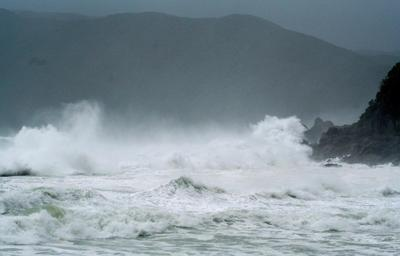 Weakened typhoon leaves two dead, heads north from...