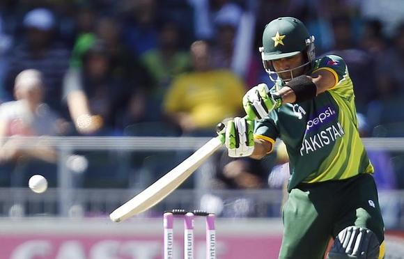 Pakistan's Mohammad Hafeez plays a shot during their third One Day International (ODI) cricket match against South Africa in Johannesburg, March 17, 2013. REUTERS/Siphiwe Sibeko/Files